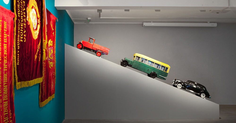 Toy truck, bus and car from Work and Play Behind the Iron Curtain at GRAD Gallery